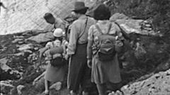 Switzerland 1943: people walking in a mountain trail Stock Footage