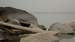 Spring sea with stones, log and bird. 1 - stock footage