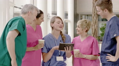 4K Cheerful medical team having a group discussion with computer tablet Stock Footage