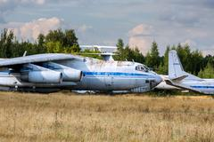 Old russian aircrafts at the abandoned aerodrome in summertime. Cemetery of l - stock photo