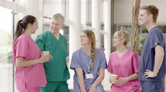 4K Cheerful medical team having a group discussion in modern hospital Stock Footage