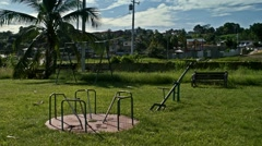 Wide shot playground glide right to left Stock Footage