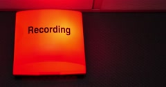 Close up footage of a recording sign, it is being turned on and off Stock Footage