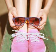 Pink cool girl, gumshoes and sunglasses, fashion, summer, youth - concept Stock Photos