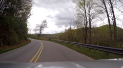 Driving up on downed power line mountains Stock Footage