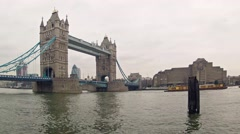 Tower Bridge at cloudy and foggy day in London Stock Footage