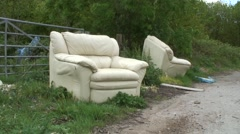 Fly tipping of two old sofas 06 Stock Footage