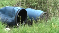 Fly tipping Two oil drums 01 Stock Footage
