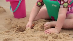 Baby playing with sand in beach Stock Footage