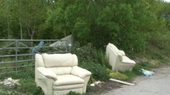 Fly tipping of two old sofas 07 Stock Footage