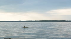 Young man rowing boat in lake Stock Footage