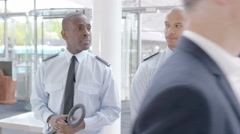 4K Portrait of smiling airport security guards on duty - stock footage