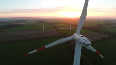 Muensterland, Germany - 20 April 2015, Wind turbines at sunset producing energy - stock footage