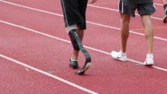 Paralympic games. Runners. Track.  Prosthesis Stock Footage
