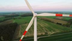 Flying past wind turbine in field - stock footage