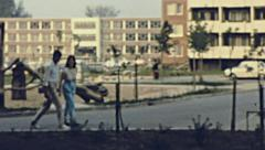 East Germany 1964: couple of young lovers in walking in a residential district - stock footage