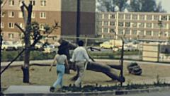 East Germany 1964: couple of young lovers in walking in a residential district Stock Footage