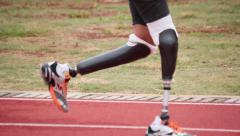 Paralympic games. Runners. Track. Prosthesis. Stock Footage