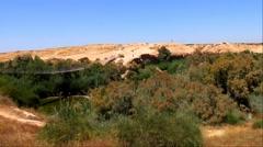 Suspension bridge and  Besor Brook  in Eshkol National Park, Negev desert Stock Footage