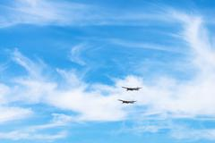 Two strategic bomber aircrafts in white clouds Stock Photos