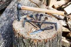 hew axe and metal hardware on wooden block - stock photo