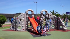 Kids with parents playing on new playground in Batumi Stock Footage