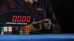 Mid Shot of solving the Rubik's Cube puzzle Stock Footage
