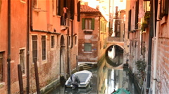 Narrow side canal in Venice Italy Stock Footage