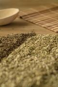 Spice fennel, cumin on a wooden table. - stock photo