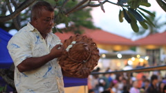 Man Weaves a Hat on GUAM, USA- CIRCA February, 2011 Stock Footage