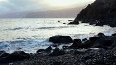 Tenerife, waves washing rocks on beach in Puerto De La Cruz Stock Footage