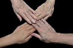family hands on black - stock photo