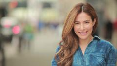 Young hispanic caucasian woman in city smile happy face portrait Arkistovideo