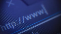 Typing anonymous web page on computer screen Stock Footage