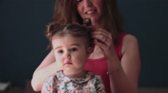Mother doing child hair at home Stock Footage