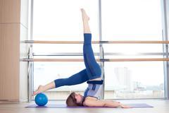 Pilates woman stability ball gym fitness yoga exercises girl Kuvituskuvat