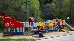 Kids with parents playing on new playground Stock Footage