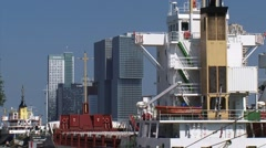 ROTTERDAM Modern architecture city skyline rising up from behind sea vessel Stock Footage