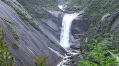 A fast flowing waterfall in Japan - Mid-Shot Stock Footage