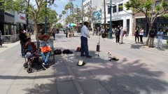 EDITORIAL - Street performer singing Dean Martin and Frank Sinatra wider Stock Footage