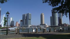 Rotterdam skyline Kop van Zuid peninsula behind waterfront Stock Footage