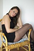 beautiful model posing in black dress and pantyhose - stock photo