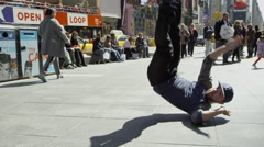 Hip hop breakdancer difficult dance move Times Square street slow motion 4K NYC Stock Footage
