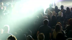 Audience crowd cheerfully applaud clapping hands in air at the concert show Stock Footage