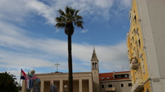 Flags at the square from the Croatian National Theatre building in Split Croatia Stock Footage