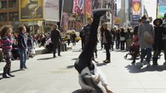 Hip hop dancer breakdancing windmills crowded Times Square slow motion 4K NYC Stock Footage