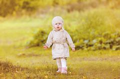 Little girl child walking in autumn day - stock photo