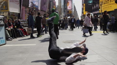 B-boy doing windmills Times Square dancer breakdancing public slow motion 4K NYC Stock Footage