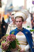 Young damadel Middle Ages at the Palio with flowers - stock photo