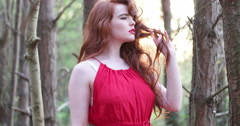 Stylish Woman in Red Dress Stock Footage